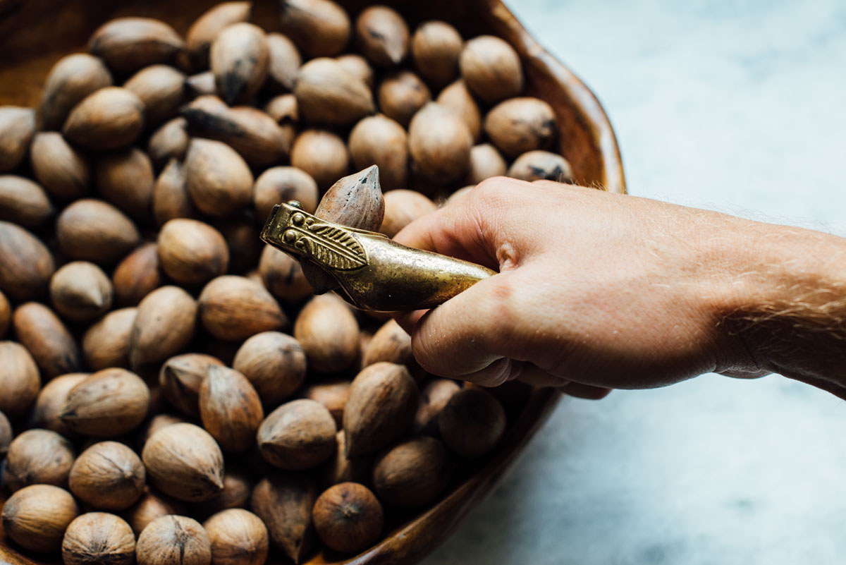whole pecans being cracked